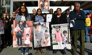 Supporters of the Biloela family gather outside the federal court in Melbourne