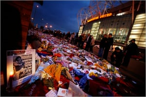 Floral tributes, shirts and scarves left outside Old Trafford after Best's death, aged 59, in November 2005.