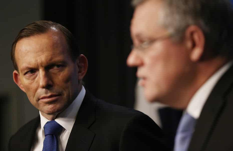 Tony Abbott, then prime minister, and Scott Morrison, then minister for immigration and border protection, at a press conference about Operation Sovereign Borders in June 2014.