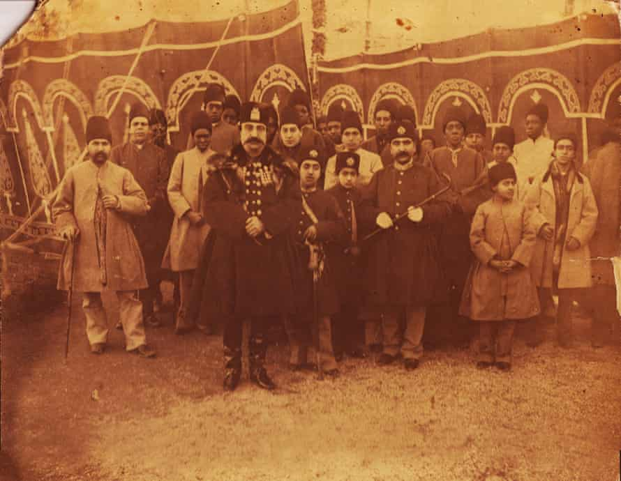 This 1895 photo was taken by one of the most important photographers of the Qajar era, Abdullah Qajar (1850-1909). In this rare photo, Nasser al-Din Shah is accompanied by his sons, members of court, and most of his favourite and influential slaves. There are 10 African eunuchs in the photo, among them Haji Firouz (the one wearing white and standing behind the king) who was one of the most trusted slaves of the king. Outside one of the royal tents, Norouz 1895 (Iranian New Year), possibly Shahrestanak, Tehran.