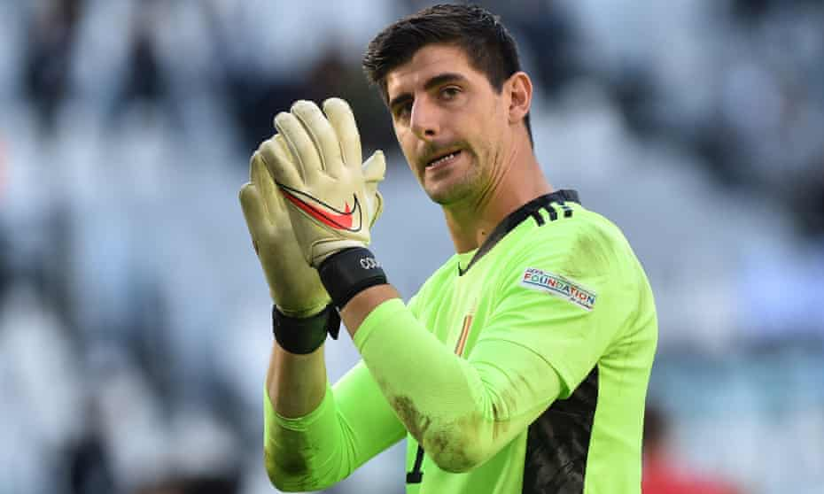 Belgium's Thibaut Courtois applauds fans after their defeat to Italy.
