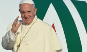 Pope Francis waves as he boards a plane  to Sarajevo on Saturday.