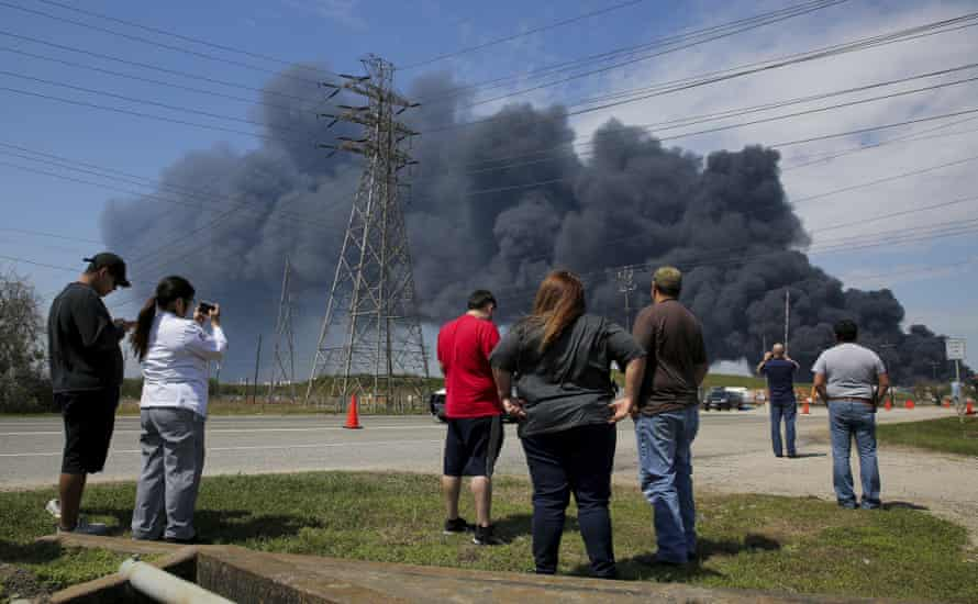 Residents watch as firefighters battle a fire at a petrochemical plant near Houston, March 2019.