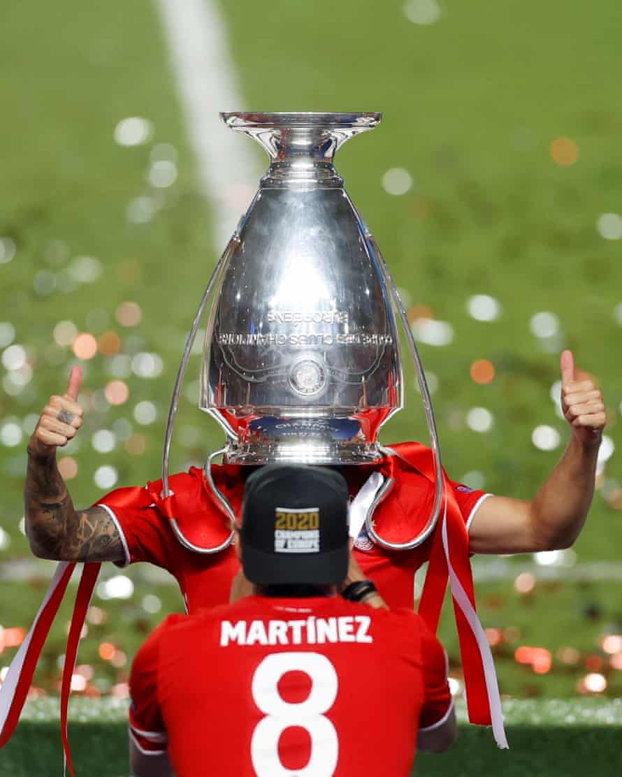 Bayern Munich's Lucas Hernandez celebrates with the trophy after beating Paris St Germain in the Champions League final at the Estadio da Luz on 23 August.