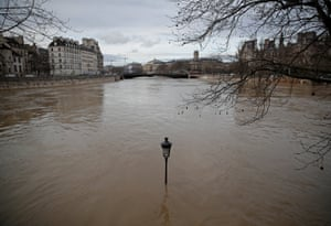 A street-lamp is seen on the flooded banks of the Seine in Paris, France, after days of almost non-stop rain caused flooding in the country in January 2018.