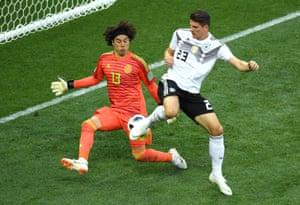 Ochoa of Mexico saves a shot from Mario Gomez.