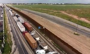 Cargo trucks line up to cross the US-Mexico border in Tijuana, Mexico.