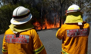 Firefighters monitor a back burn near Mount Victoria in the Blue Mountains on October 21, 2013. The intense Australian summer heat was made 5 times more likely by human-caused global warming.