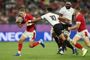 Liam Williams of Wales breaks past Ben Volavola of Fiji to go on and score his team???s fourth try.