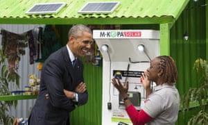 US President Barack Obama at a solar power kiosk at the Power Africa Innovation Fair in Nairobi, Kenya, during his visit last week.