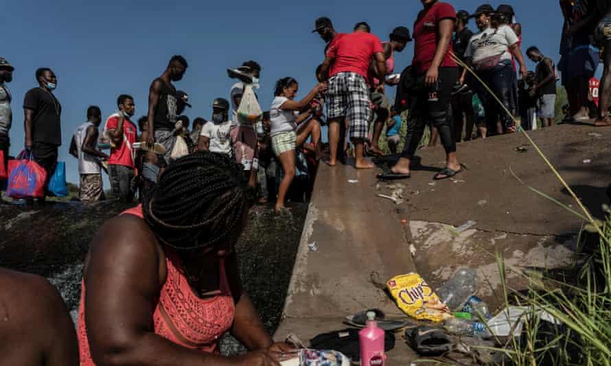 Migrants near the International Bridge in Del Rio on Thursday.