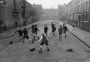 Children playing football in a London street, 1950