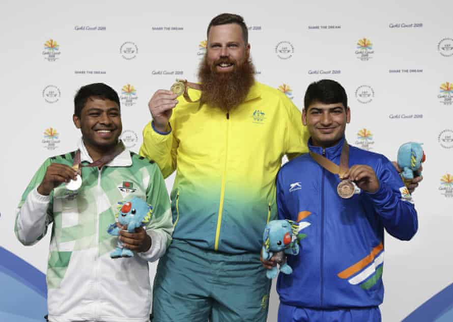 Shakil Ahmed of Bangladesh, left, silver medal, Daniel Repacholi of Australia, centre, gold medal, and Om Mitharval of India, bronze medal, after the men's 50m pistol final at the Belmont Shooting Centre during the 2018 Commonwealth Games