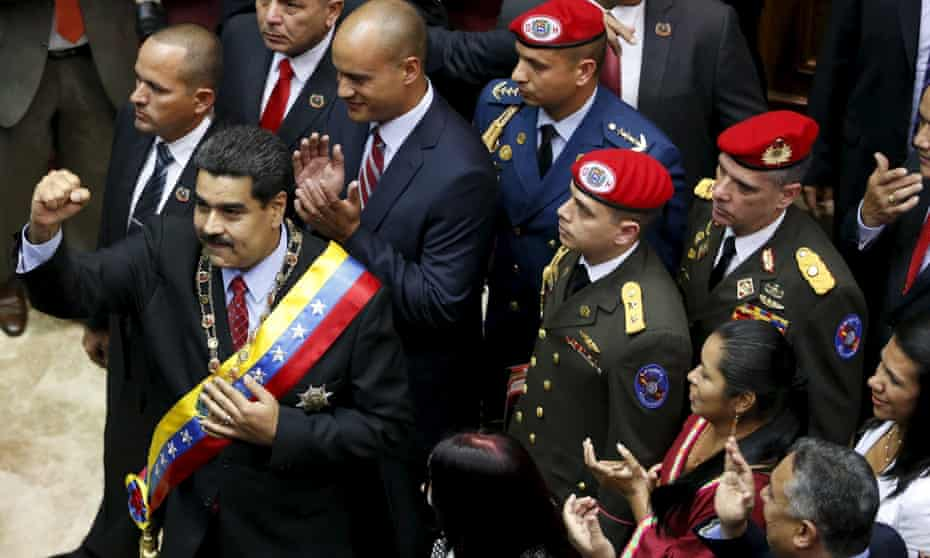 Venezuela's president Nicolas Maduro gestures before his state of the nation address to the National Assembly in Caracas on Friday when declared a national economic emergency.