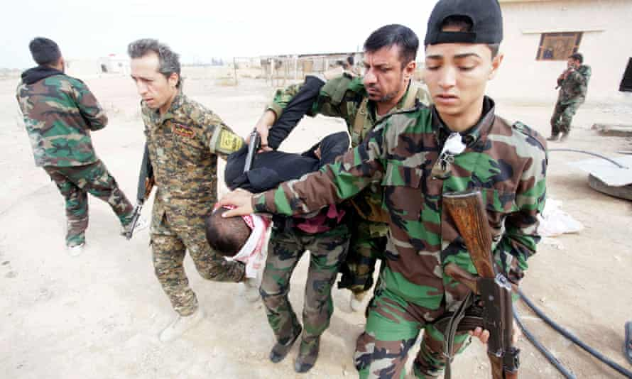 A Free Syrian Army fighter captured by Shia soldiers supporting President Assad.