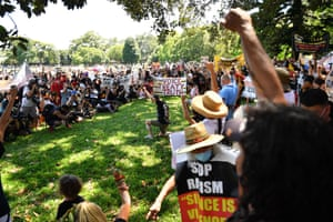 Protesters gather in a circle in The Domain, Sydney,