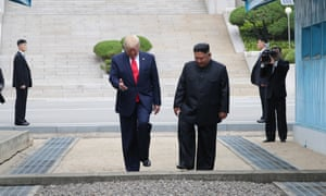 Donald Trump and Kim Jong-un cross the Military Demarcation Line into the southern side of the truce village of Panmunjom.