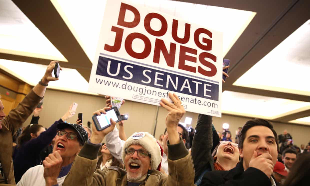 Supporters celebrate as Doug Jones is declared the winner during his election night gathering.