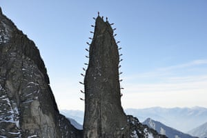 Twenty-eight climbers pause for effect while simultaneously scaling the 1,000-metre-high Ago del Torrone, in northern Italy.