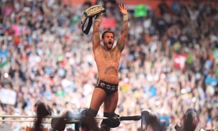 CM Punk celebrates at Wrestlemania 28.