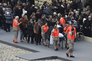 Members of the French Red Cross accompany people wounded in the Paris terror attacks