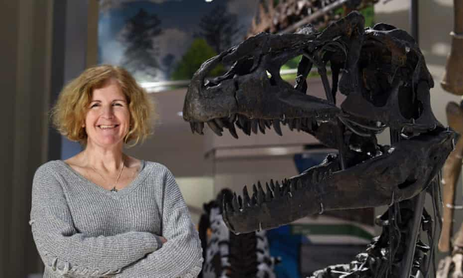 Siobhan Starrs, a museum project manager, stands next to an Allosaurus fragilis at the new fossil hall.