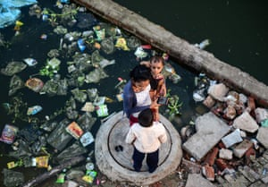 Allahabad, India: Residents stand outside their flooded home in the Ganga Nagar area