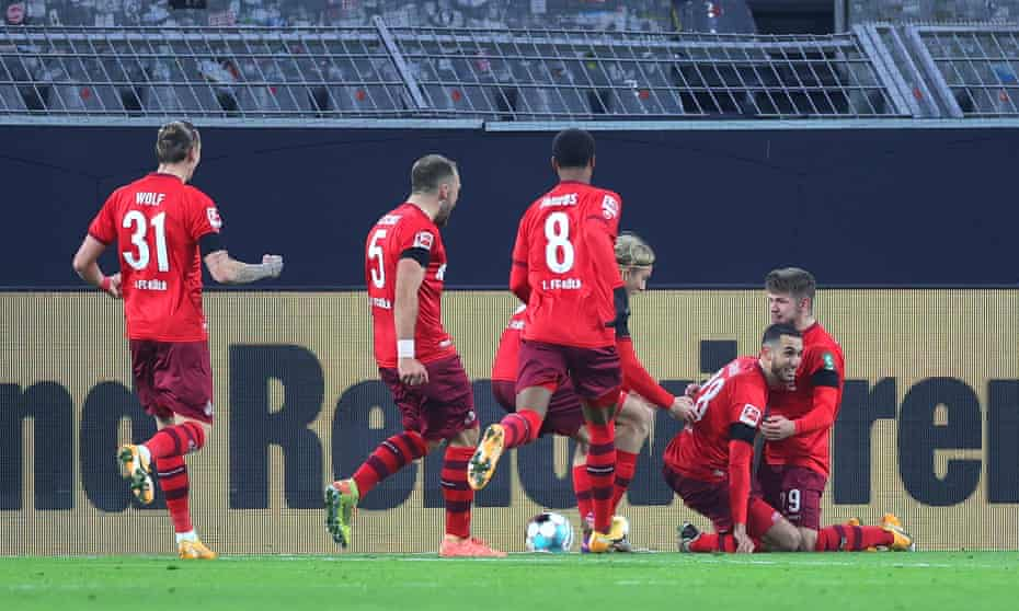 Ellyes Skhiri is mobbed by his teammates after scoring Köln's decisive second goal