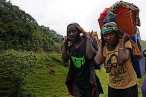 Women carry loads along the road to Numbi