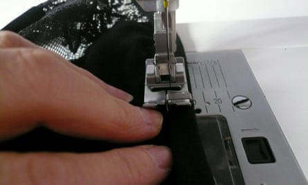 hand on sewing machine