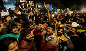 Demonstrators shout slogans during a protest against a new citizenship law in Delhi.
