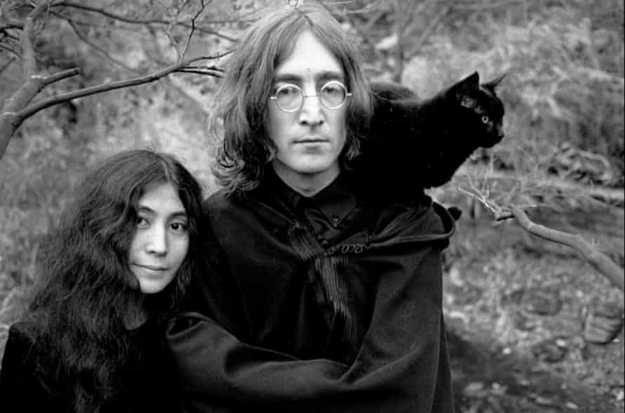 'She had been sent a doll with pins stuck in its torso' … Yoko Ono and John Lennon with their cat.