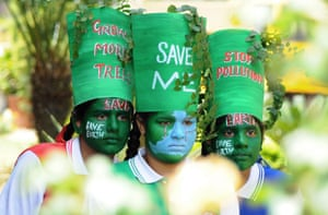 Girls take part in a 'Save the Earth' awareness programme on the eve of Earth Day, in Patiala, India