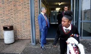 Gary Phillips and children leaving school