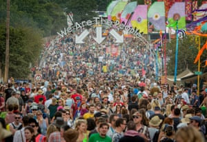 We Are The People, 2014One of the main drags through the festival starts at the Pyramid and finishes at the Stone Circle at the opposite end of the site. I take a picture like this one every year from the same raised position up on the old railway track. It's always jammed full of people marching through the archway and is a great place to shoot to show the scale to the whole thing