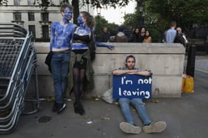 A young couple painted as EU flags protest outside Downing Street against the UK's decision to leave the EU following the referendum the day before. 25 June 2016.