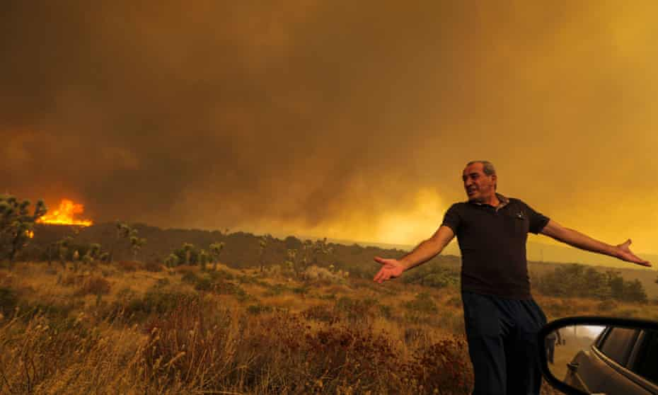 Mike Gregoryan frustrated as he asked to leave his home on Cruthers Creek as Bobcat fire reaches rages in Juniper Hills, Little Rock, California, earlier this month.