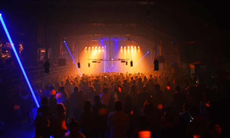 The club Bassiani has been behind a growth in international visitors to Tbilisi. Shot of a crowd at an evening event under multicoloured lighting.