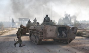Syrian rebels attack an Assad regime-controlled military academy during an operation to break the siege in Aleppo on Sunday.