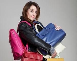 Lucy Siegle holding lots of handbags
