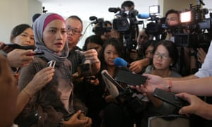 A family member speaks to the media after an MH370 briefing closed door meeting in Malaysia.