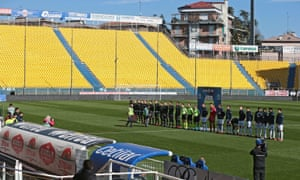 Players from Parma vs Spal line up in an empty stadium
