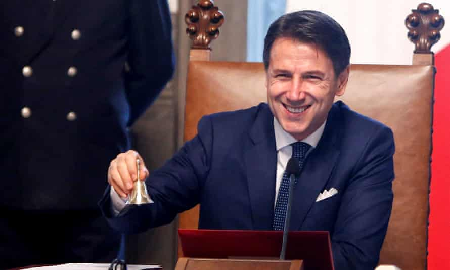 The Italian PM, Giuseppe Conte, rings a bell that traditionally opens the cabinet meeting at Chigi Palace in Rome