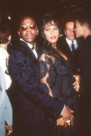 Bobby Brown and Whitney Houston in 1992; David Roberts can be seen in the background.