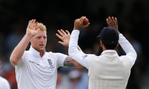 Ben Stokes and Moeen Ali celebrate after taking the wicket of Australia's Adam Voges.