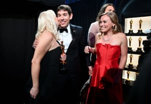 The producer of Free Solo, Shannon Dill, rock climber Alex Honnold and his girlfriend Sanni McCandless celebrate winning best documentary