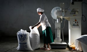 A woman bags macaroni at a food factory in Nazret, Ethiopia