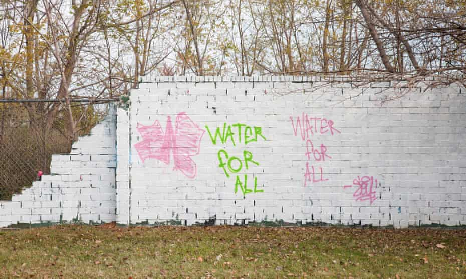 Graffiti addressing the water shutoffs covered various parts of Detroit in 2014. The city has since painted over almost all of the graffiti in that area, including the one shown.