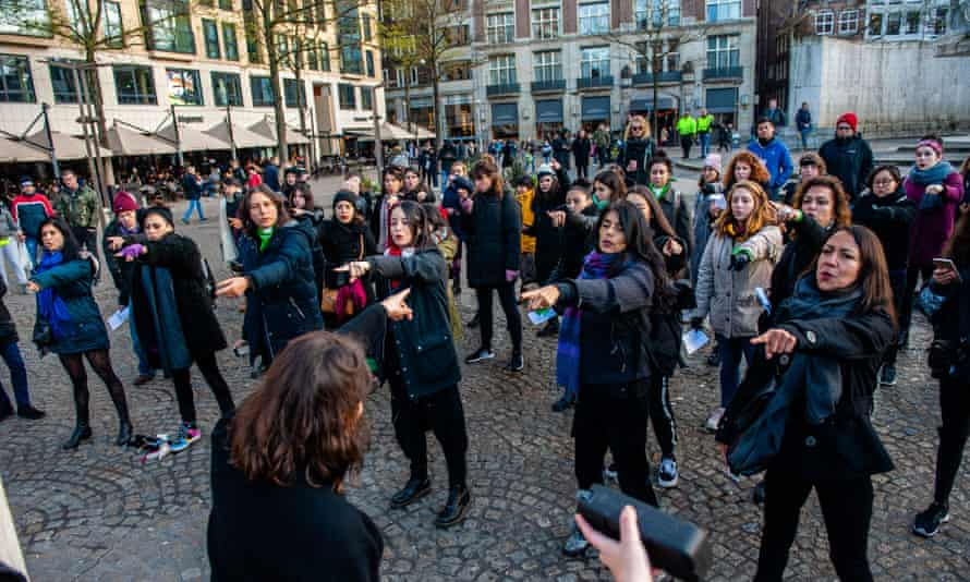 A group of Chilean women rehearsing the dance for Un Violador en Tu Camino during a demonstration in Amsterdam on 1 December.