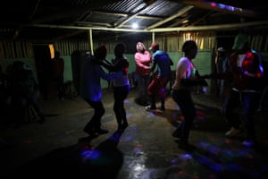Residents dance at a bar. Sunday evening is the only time when the bar is open and residents gather there to socialise and dance